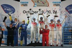 P1 podium: class and overall winners Allan McNish and Rinaldo Capello, second place Marco Werner and