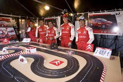 Sébastien Loeb, Daniel Elena, Daniel Sordo and Marc Marti play slot cars