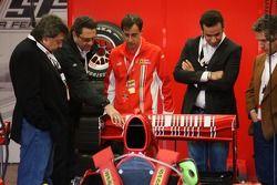 Tony Teixeira of A1GP and Richard Dorfman of A1GP take a look at a Ferrari F1 car