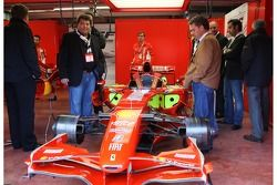Tony Teixeira of A1GP and Pete da Silva of A1GP take a look at a Ferrari F1 car