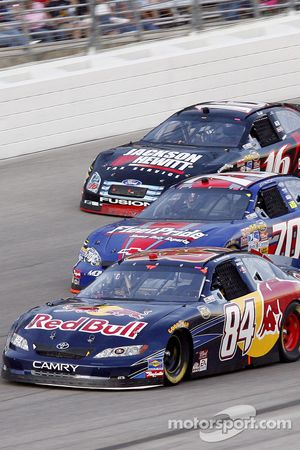 Brian Vickers leads Johnny Sauter and Greg Biffle