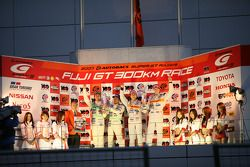 Championship podium: GT300 champions Kazuya Oshima and Hiroaki Ishiura, GT500 champions Daisuke Ito and Ralph Firman