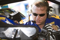 Crew chief Larry Carter talks to his driver Jamie McMurray