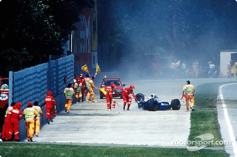 The fatal crash of Ayrton Senna at Tamburello: safety team members come to the rescue