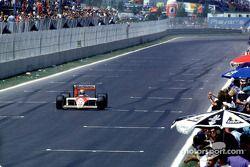Ayrton Senna takes the checkered flag
