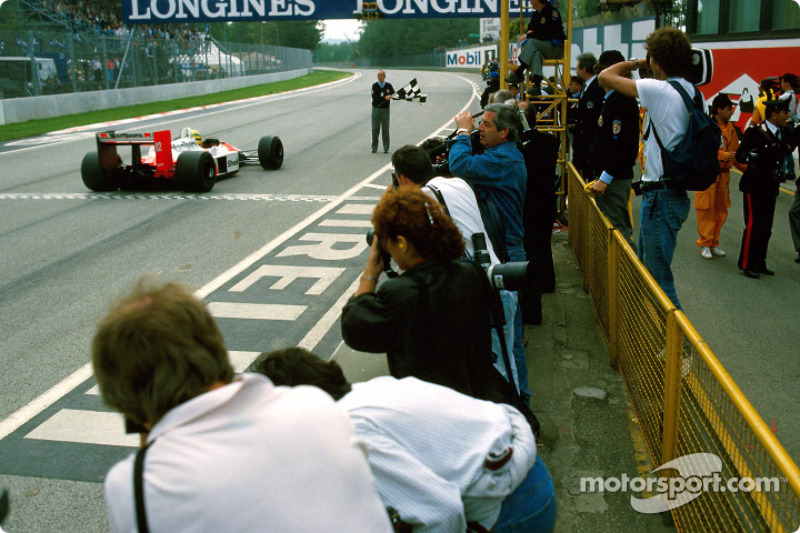 Ayrton Senna takes checkered flag