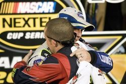 Championship victory lane: 2007 NASCAR Nextel Cup champion Jimmie Johnson with Casey Mears