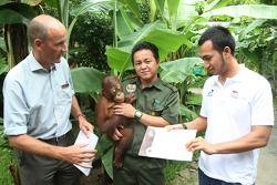 Satrio Hermanto, driver of A1 Team Indonesia adopts an Orang Utan