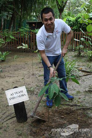Satrio Hermanto, driver of A1 Team Indonesia planting a tree