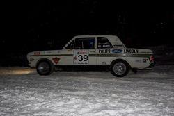 Rick drives his 67 Ford Cortina GT through Castledine's Corner honking the horn for spectators