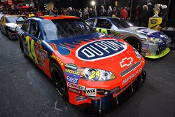 The cars of Jeff Gordon and Jimmie Johnson wait on the street in Time Square prior to a victory lap