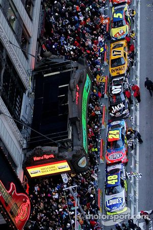 Nextel Cup Series drivers, lead by Jimmie Johnson, the 2007 NASCAR Nextel Cup Series Champion, park outside the Hard Rock Cafe at Times Square after completing a victory lap through the streets of midtown New York City