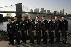 NASCAR champions LW Miller, Joey Logano, Steve Carlson, Ron Hornaday, Jimmie Johnson, Carl Edwards, Andrew Ranger, Mike David and Donny Lia pose with the Brooklyn Bridge as the backdrop
