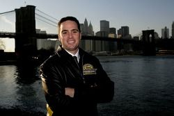 2007 NASCAR NEXTEL Cup Series champion Jimmie Johnson poses in front of the Brooklyn Bridge