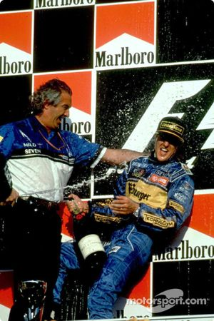 Podium: race winner and 1995 Formula One World Champion Michael Schumacher celebrates