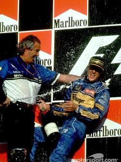Podium: race winner and 1995 Formula One World Champion Michael Schumacher celebrates
