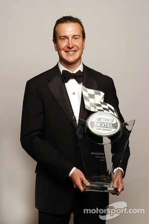 Kurt Busch poses with the trophy for the seventh place driver in the NASCAR NEXTEL Cup Series standings