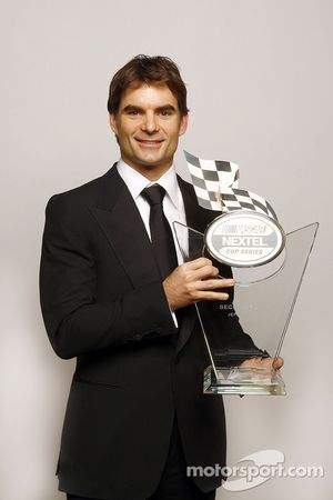 Jeff Gordon holds the trophy given to the second place driver in the NASCAR NEXTEL Cup Series standings