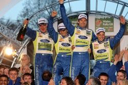 Podium winners Mikko Hirvonen and Jarmo Lehtinen, second place Marcus Gronholm and Timo Rautiainen
