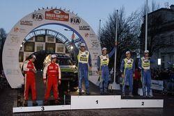 Podium winners Mikko Hirvonen and Jarmo Lehtinen, second place Marcus Gronholm and Timo Rautiainen,