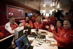 Citroen Total WRT team members celebrate as Sébastien Loeb clinches the 2007 World Rally Championshi