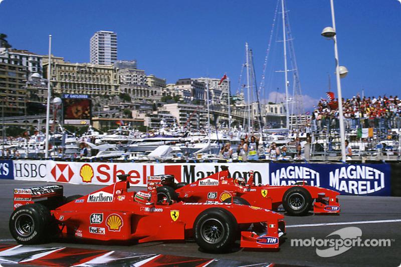 Race winner Michael Schumacher celebrates with second place Eddie Irvine
