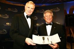 FIA President Max Mosley presents the prestigious FIA Gold Medal for Motor Sport to Mario Andretti
