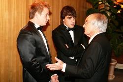 Formula One drivers Kimi Raikkonen and Fernando Alonso with FOM President Bernis Ecclestone