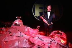 Ice man and machine: Kimi Raikkonen and an ice sculpture of a Ferrari Formula One car
