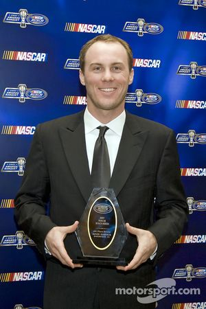 Fourth place driver, Kevin Harvick, receives his award