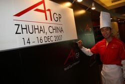 Dim Sum Making event: Congfu Cheng, driver of A1 Team China signing an autograph