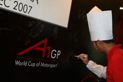 Dim Sum Making event: Satrio Hermanto, driver of A1 Team Indonesia, signing an autograph