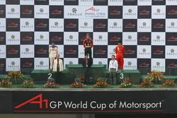 Podium: race winner Michael Ammermuller with second place Neel Jani and third place Congfu Cheng