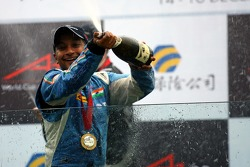 Podium: race winner Narain Karthikeyan