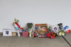 Tributes to Jules Bianchi are placed beside the Manor Marussia F1 Team pit garage