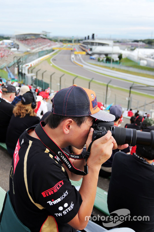 An amateur photographer in the grandstand