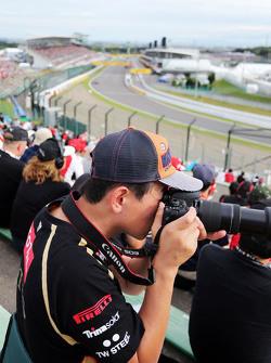 An amateur photographer в grandstand