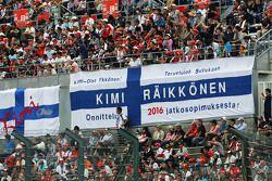 Fans in the grandstand and banners for Kimi Raikkonen, Ferrari