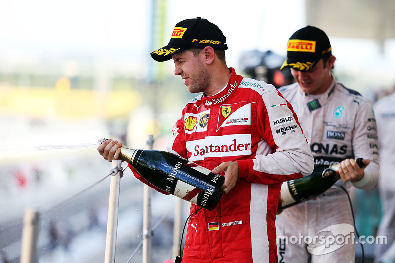 Sebastian Vettel, Ferrari celebrates his third position with the champagne on the podium