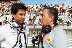 Toto Wolff, Mercedes AMG F1 Shareholder and Executive Director with Mario Isola, Pirelli Racing Manager on the grid