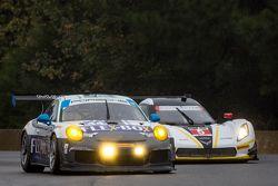 #44 Magnus Racing Porsche 911 GT America: John Potter, Andy Lally, Robert Renauer and #5 Action Express Racing Corvette DP: Joao Barbosa, Christian Fittipaldi, Sébastien Bourdais
