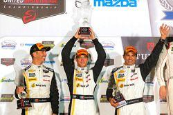 Overall podium: second place Joao Barbosa, Christian Fittipaldi, Sébastien Bourdais, Action Express Racing