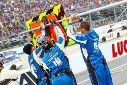 Crew members prepare the pit sign for Dale Earnhardt Jr., Hendrick Motorsports Chevrolet