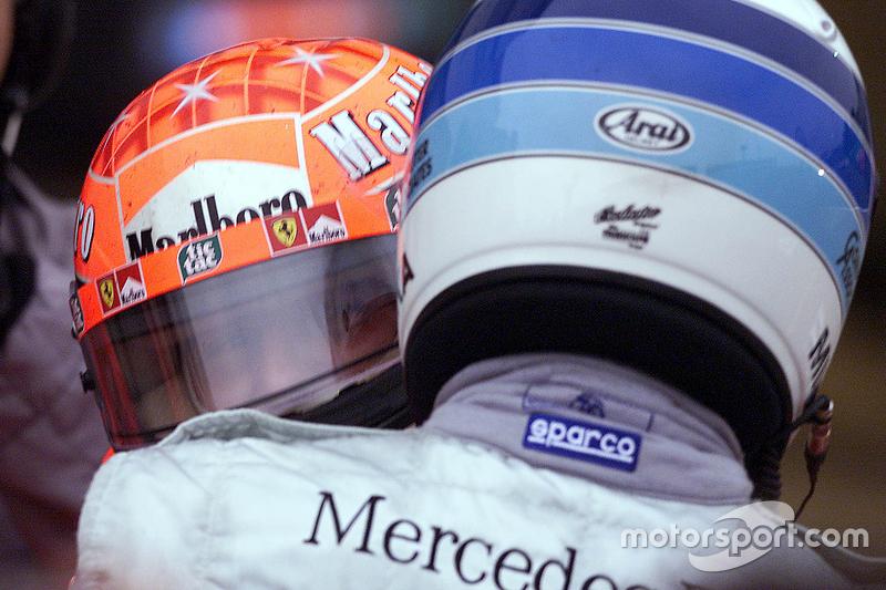 Ganador de la carrera y Campeon del Mundo del 2000 Michael Schumacher, Ferrari y Mika Hakkinen, McLa