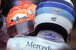 Race winner and 2000 World Champion Michael Schumacher, Ferrari and Mika Hakkinen, McLaren