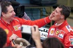 Race winner and 2000 World Champion Michael Schumacher, Ferrari with Jean Todt