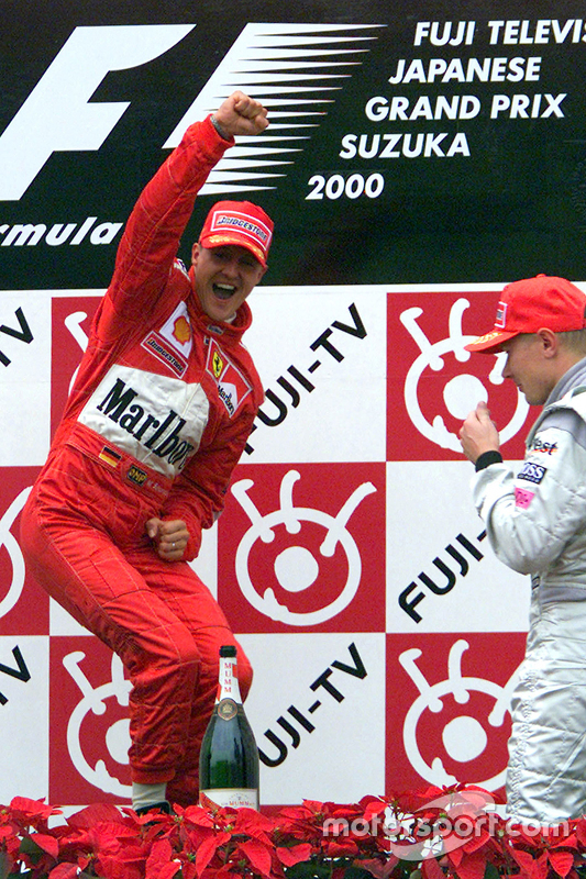 Podium: race winner and 2000 World Champion Michael Schumacher, Ferrari, second place Mika Hakkinen,