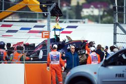 The Scuderia Toro Rosso STR10 of Carlos Sainz Jr., is removed from the circuit after he crashed in the third practice session