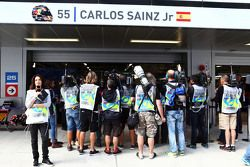 The media gather around the pit garage of Carlos Sainz Jr., Scuderia Toro Rosso in the third practice session