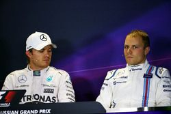 (L to R): Nico Rosberg, Mercedes AMG F1 and Valtteri Bottas, Williams in the post qualifying FIA Press Conference